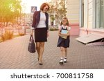 mother businesswoman takes the... | Shutterstock . vector #700811758