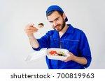 handsome guy delivering sushi