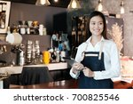 young asian woman using tablet... | Shutterstock . vector #700825546