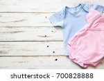 pink and blue baby romper on... | Shutterstock . vector #700828888