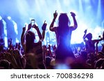 crowd making a photos while... | Shutterstock . vector #700836298