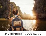 woman with backpack swims on... | Shutterstock . vector #700841770