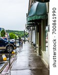 Small photo of Belfast, USA - June 9, 2017: Empty small village in Maine during rain with buildings and stores on main street