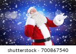 santa claus with headphones... | Shutterstock . vector #700867540