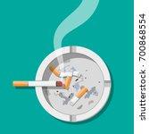 white ceramic ashtray full of... | Shutterstock .eps vector #700868554