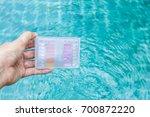 girl hand holding water testing ...   Shutterstock . vector #700872220