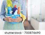 woman with cleaning equipment... | Shutterstock . vector #700876690