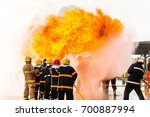 firefighters in action ... | Shutterstock . vector #700887994