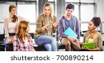 happy students talking with... | Shutterstock . vector #700890214
