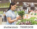 serene female making choice of... | Shutterstock . vector #700892458