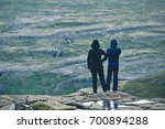 tourists in warm clothing... | Shutterstock . vector #700894288