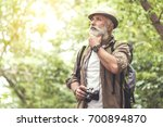 thoughtful senior man using... | Shutterstock . vector #700894870