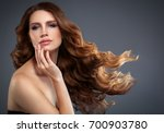 woman with red lipstick. curly... | Shutterstock . vector #700903780