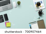 office workplace with laptop ... | Shutterstock . vector #700907464