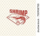 shrimp logo on seamless pattern ... | Shutterstock .eps vector #700908700