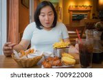 fat asian woman happy with fast ... | Shutterstock . vector #700922008