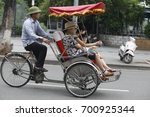 """Small photo of hanoi,vietnam jul 22, 2017: Visit Hanoi by cyclo to dive in the soul of Hanoi. This """"authentic"""" way allow visitors discover the city center in intense emotions. this is Hanoi culture"""