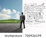 a businessman between a calm...   Shutterstock . vector #700926199