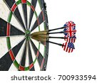 Small photo of Metal darts have hit the red bullseye on a dart board. Darts Game. Darts arrow in the target center darts in bull's eye close up. Success hitting. isolated on white