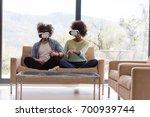 multiethnic couple using... | Shutterstock . vector #700939744