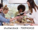 multiethnic group of happy... | Shutterstock . vector #700943410