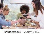 multiethnic group of happy... | Shutterstock . vector #700943413