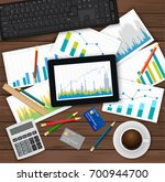 vector desk with financial and... | Shutterstock .eps vector #700944700