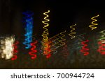 colored lights in motion of... | Shutterstock . vector #700944724