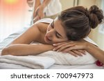 woman relaxing with hand... | Shutterstock . vector #700947973