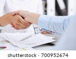 partnership agreement closeup... | Shutterstock . vector #700952674