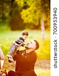 happy family with her son in a... | Shutterstock . vector #700953940