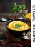 pumpkin cream soup with cream... | Shutterstock . vector #700955170