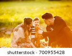 mother  father and son in the... | Shutterstock . vector #700955428