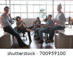 group of a young business... | Shutterstock . vector #700959100