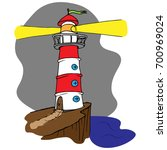red white lighthouse on a... | Shutterstock .eps vector #700969024