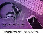 song on mobile downloading...   Shutterstock . vector #700979296
