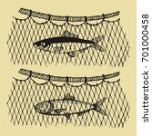 fish in a vector fishing net.... | Shutterstock .eps vector #701000458