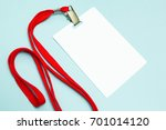 Small photo of Blank badge mockup isolated on blue. Plain empty name tag with red string.