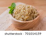 cooked quinoa in a wooden bowl | Shutterstock . vector #701014159