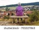 older woman sitting on bench... | Shutterstock . vector #701027863