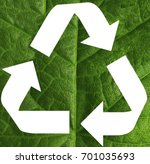 recycling sign on green leaf | Shutterstock . vector #701035693