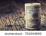 dollars rolled banknotes... | Shutterstock . vector #701043850