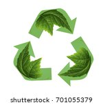 recycling sign on green leaf | Shutterstock . vector #701055379