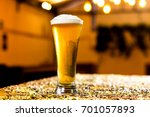 lager beer glass in a pub | Shutterstock . vector #701057893