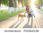 Stock photo young mother and little child boy plays with a dog on the grass puppy shiba inu playing with happy 701063128
