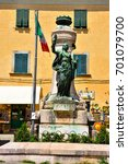 Small photo of MONTECATINI ALTO ITALY AUGUST 16: Monument to the fallen in the medieval village square, - August 16 2017 Montecatini Alto, Italy