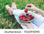 girl in jeans sitting in summer ... | Shutterstock . vector #701095090