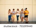 group of young good looking... | Shutterstock . vector #701099440