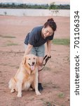 woman with her golden retriever ... | Shutterstock . vector #701106334