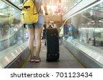 asian woman traveler standing... | Shutterstock . vector #701123434